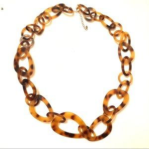 Tortoise shell chain link necklace.